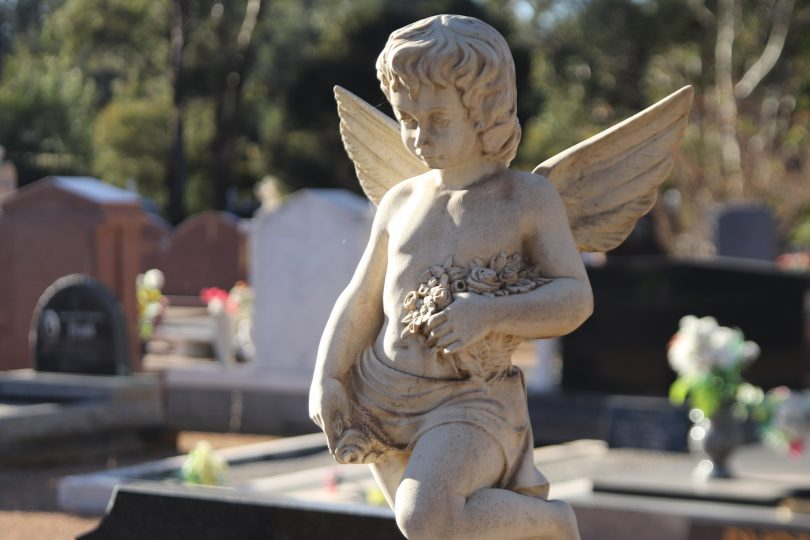 Angel statue on a grave at Gungahlin Cemetery